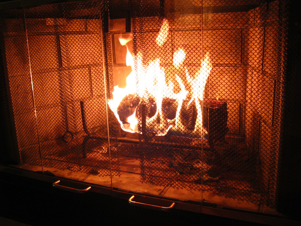 a lit log in a fireplace