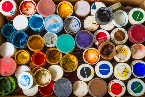 assorted used and open paint cans