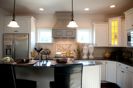 kitchen with white cabinets, granite countertops, and stainless steel appliances