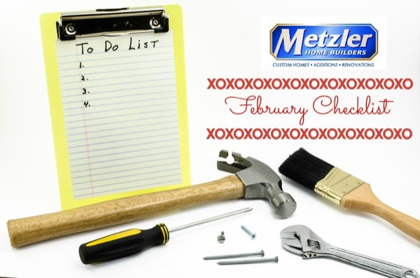 "empty to do list with several tools and the metzler home builders logo with ""february checklist"" written"