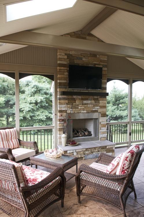 stone fireplace and backyard seating area