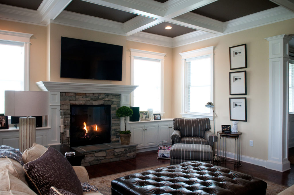 living room with fireplace and coffered ceiling
