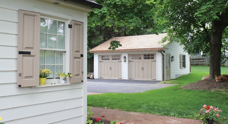 a detached two car garage behind a home