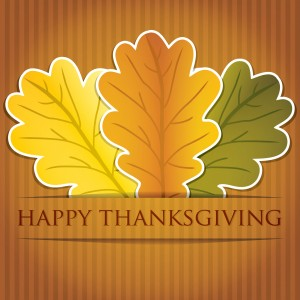 happy thanksgiving graphic with three fall leaves