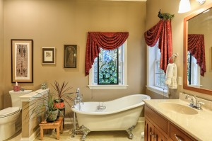 master bathroom with soak tub and his/her vanities