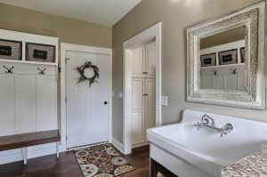 laundry room with built in storage, sink and hangers