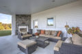 covered outdoor patio area with furniture and fireplace