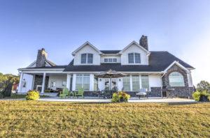 custom story and a half home exterior