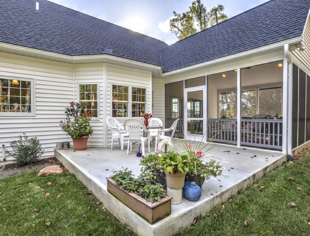 small patio next to a sunroom