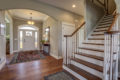 entryway with wood floors and staircase