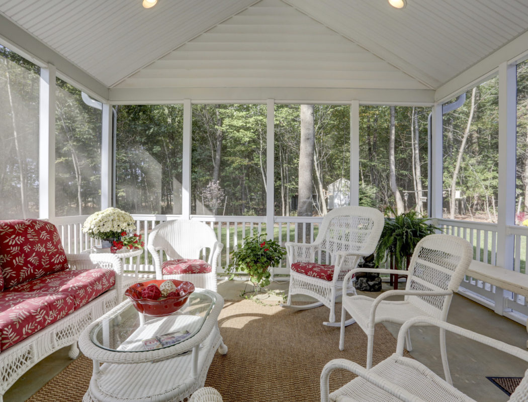 seating area inside of a screened porch