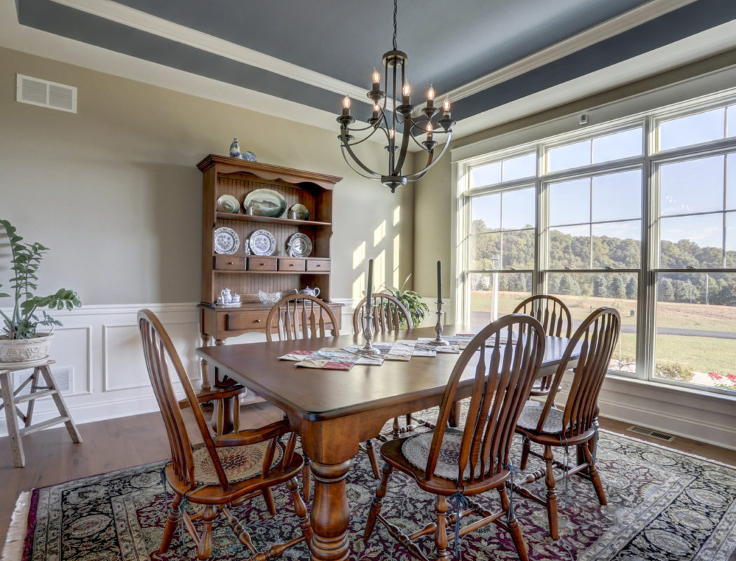 dining room table with cabinet and large windows