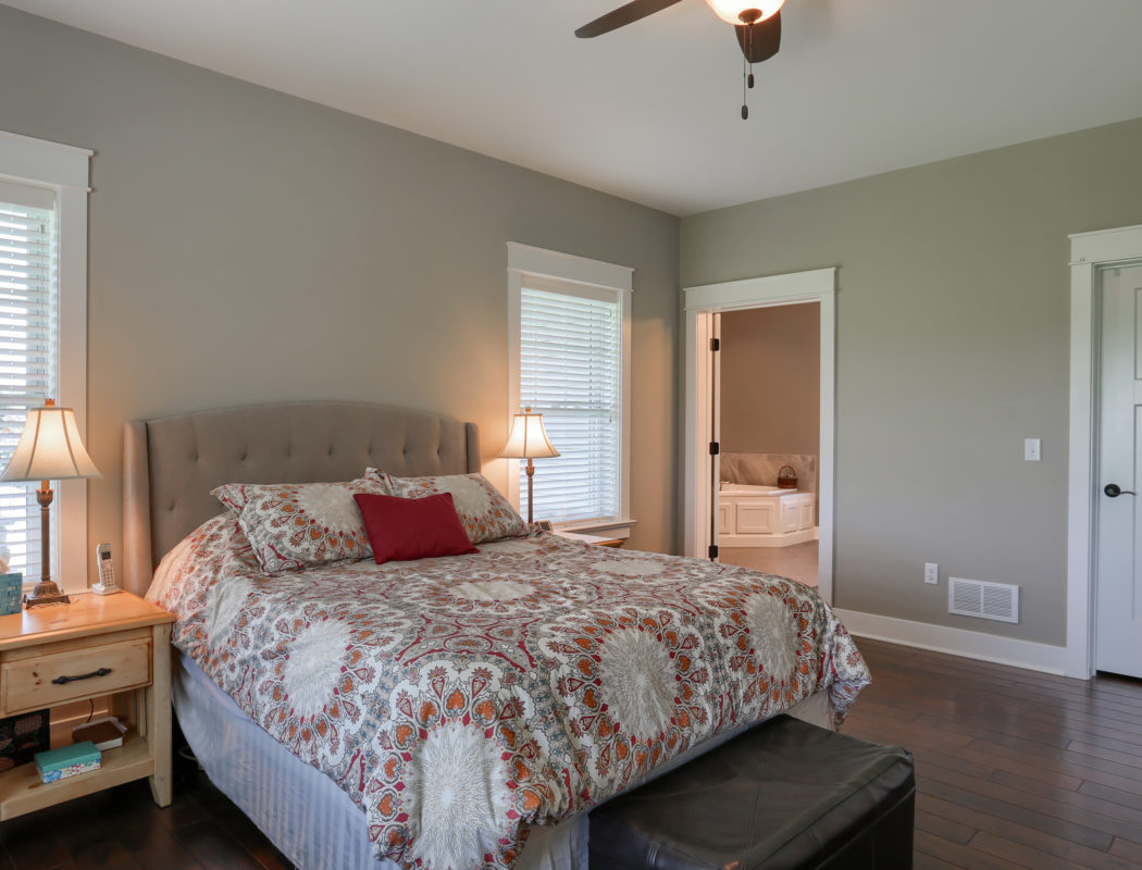 Bedroom with master bath in the background