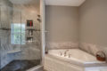 walk-in shower and soak tub