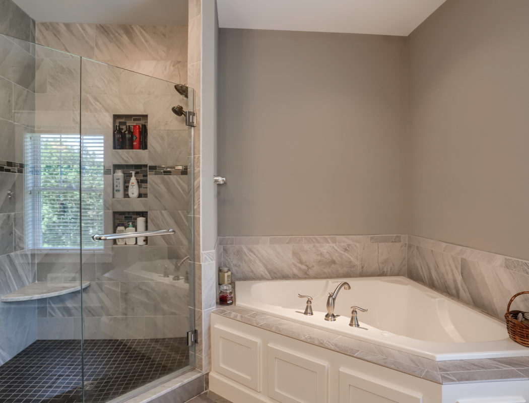 a new metzler bathroom with walkin shower and large tub