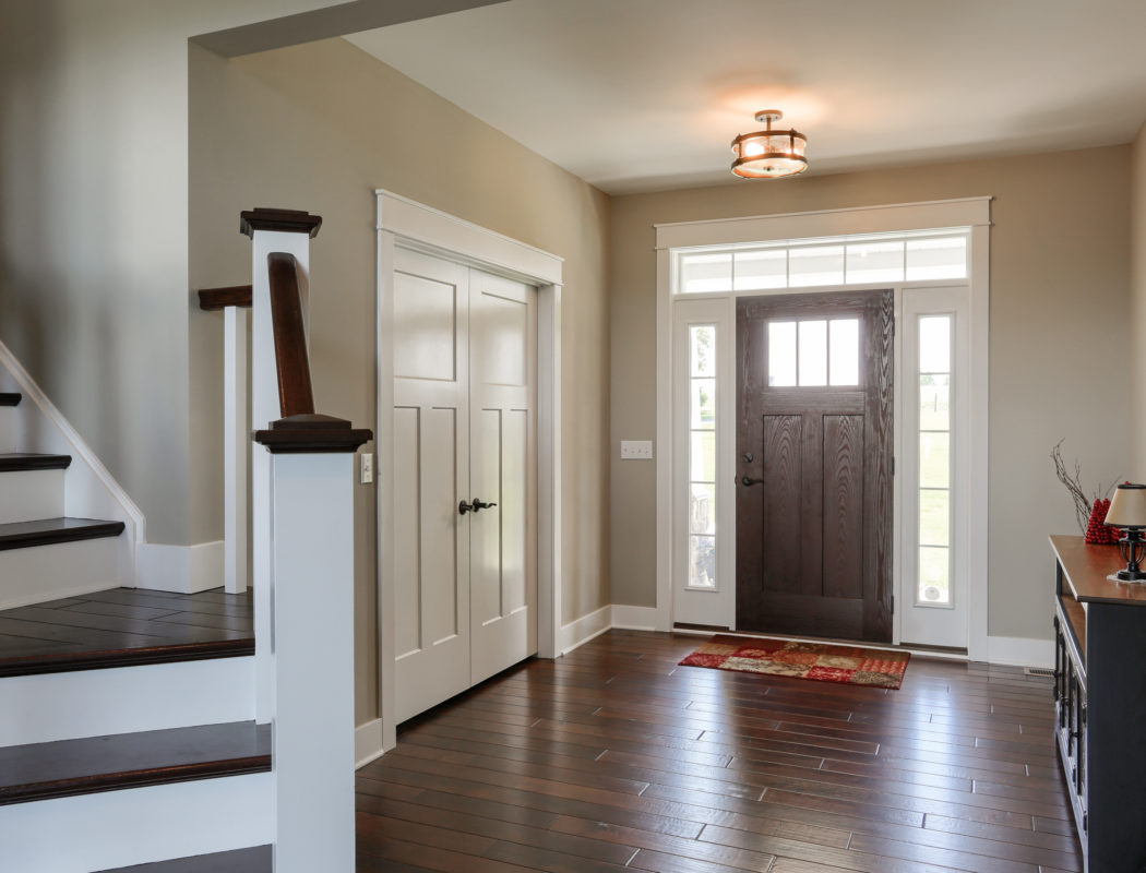 entryway inside the home and staircase to 2nd floor