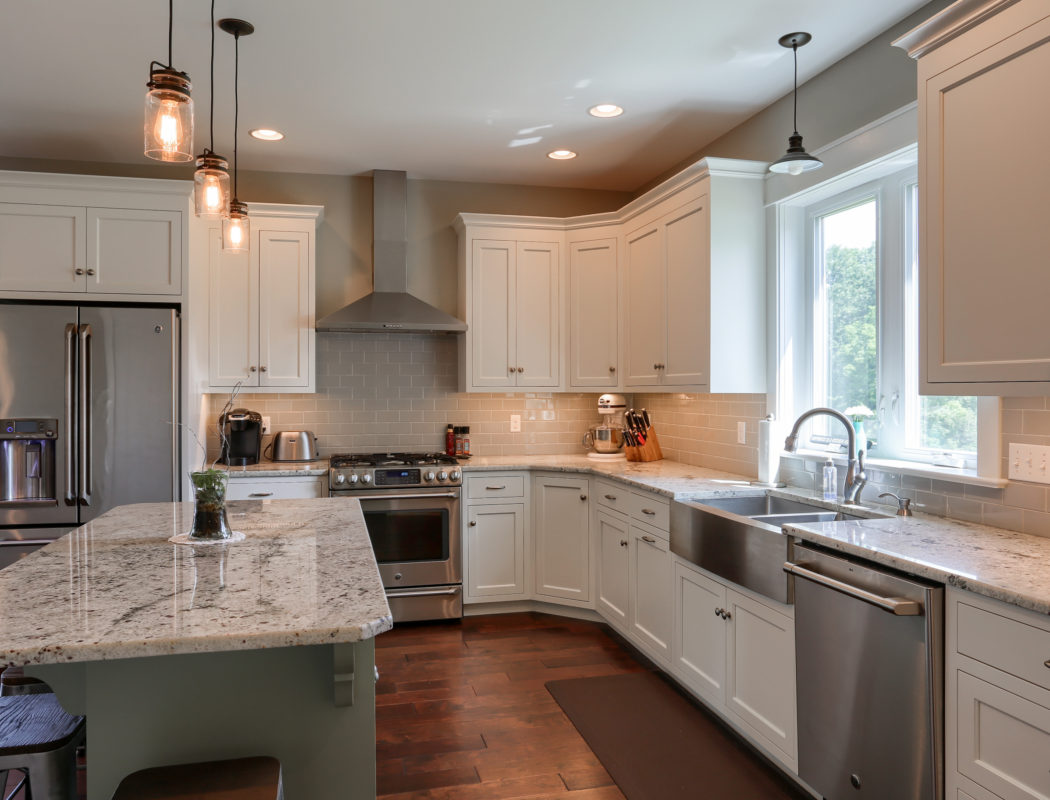 kitchen with island, white cabinets and stainless steel appliances