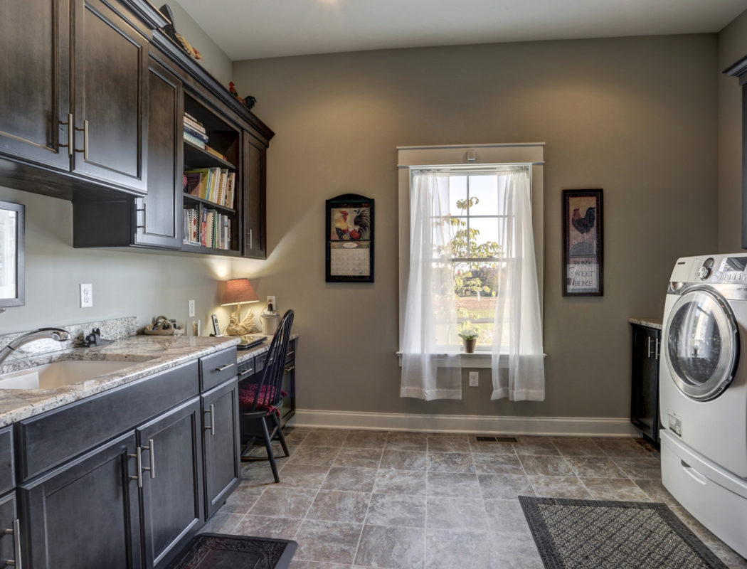 washroom with cabinets and desk