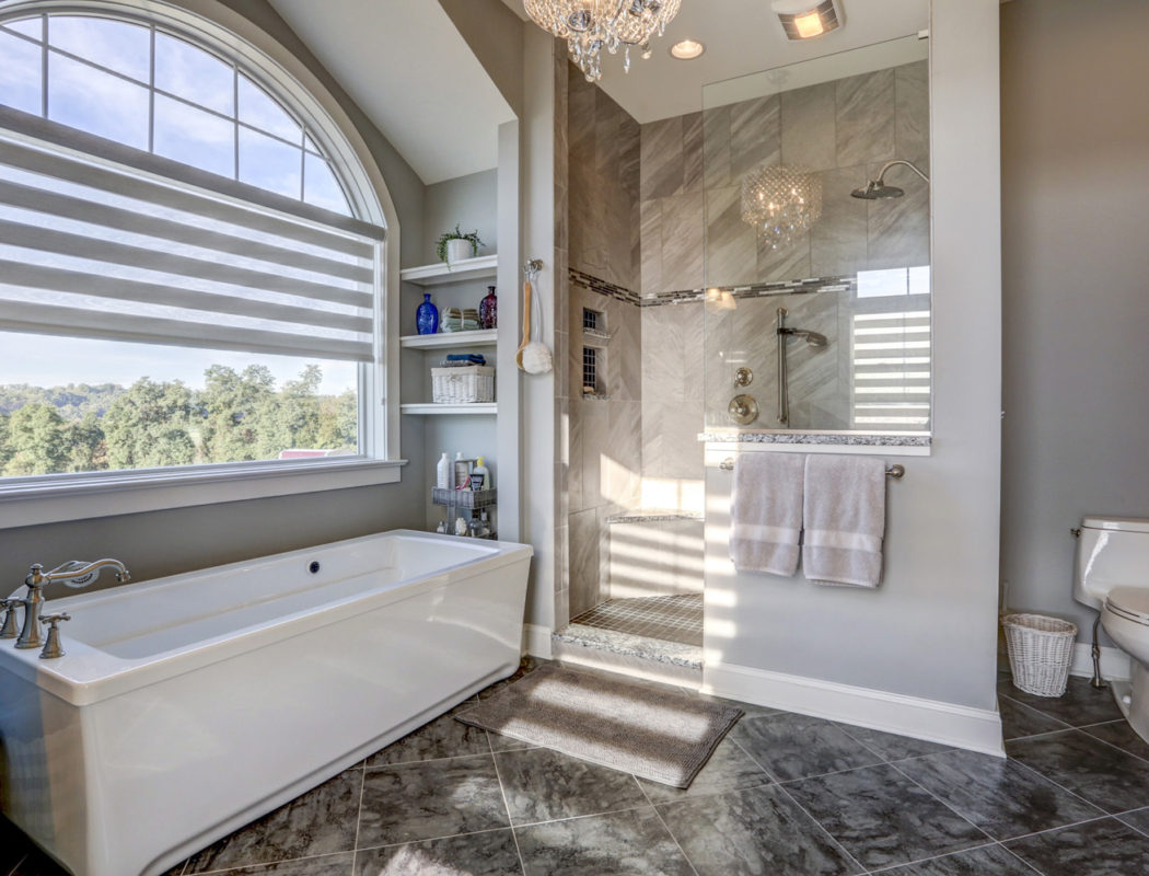 a new metzler bathroom featuring a walk in shower