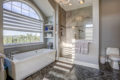 master bath with tub and walk-in shower