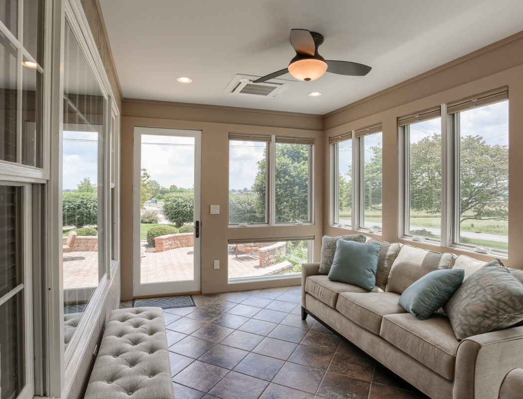covered backdoor patio area with fan