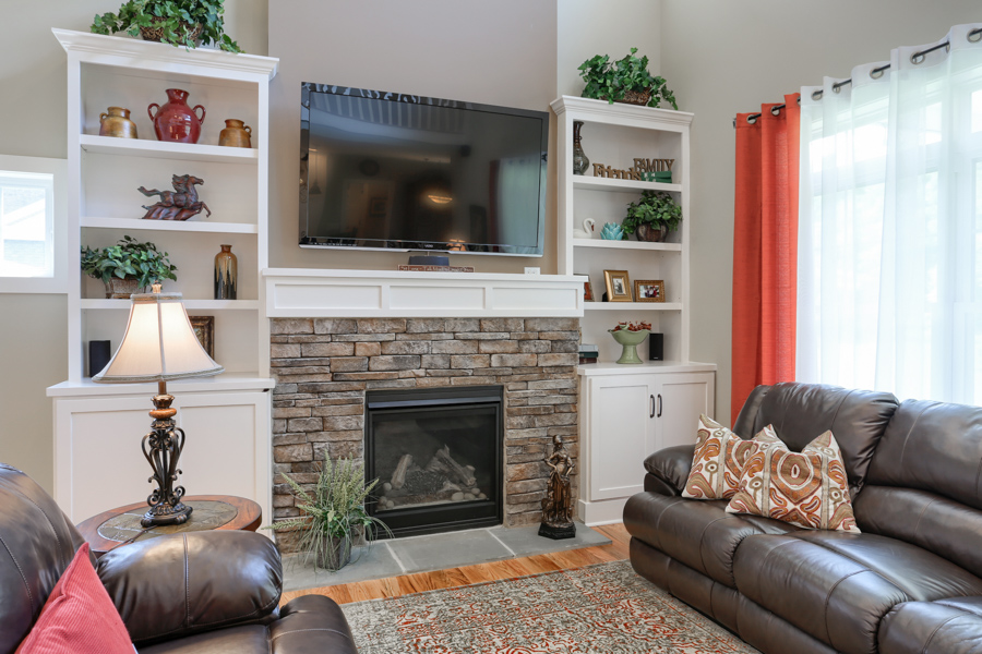 close up of stone fireplace and shelving that stands beside it