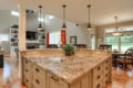 large stone countertop bar area with white drawers underneath
