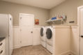 washer and dryer with shelf overhead