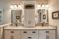 his/her vanities in a large master bathroom