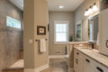 walk in shower walled off from the toilet and vanity area