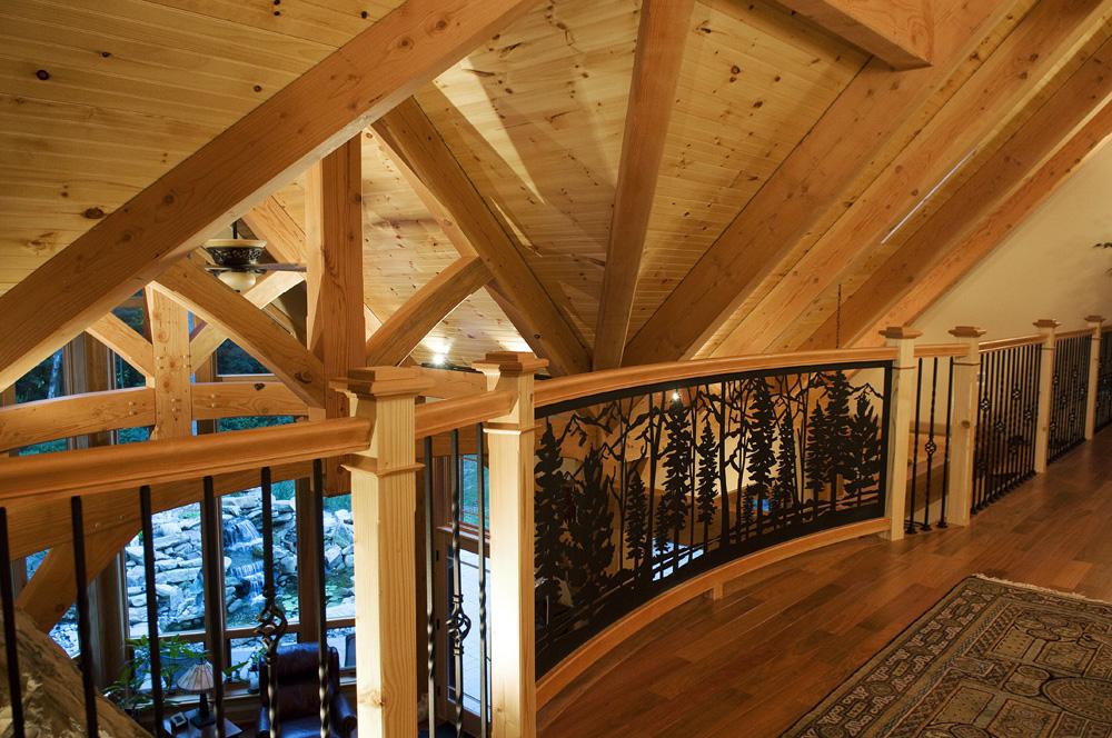 custom woodwork on railing and ceiling