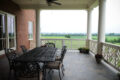 patio furniture on a deck overlooking farmland