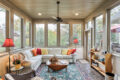 a sunroom with a wraparound couch