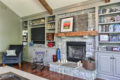 stone fireplace after with built in shelves