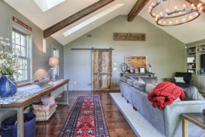 after vaulted ceiling family room with sliding barn door