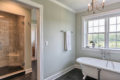 country farmhouse tub and walk-in shower