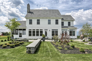 country farmhouse exterior rear patio and landscaping