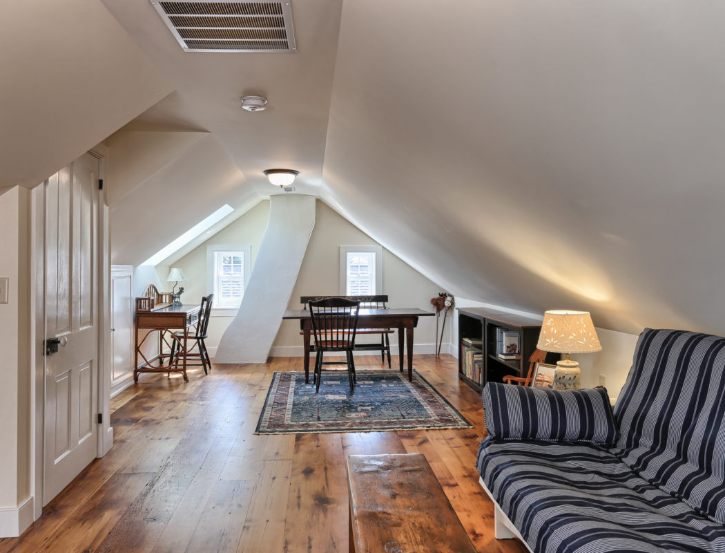 a finished and furnished attic
