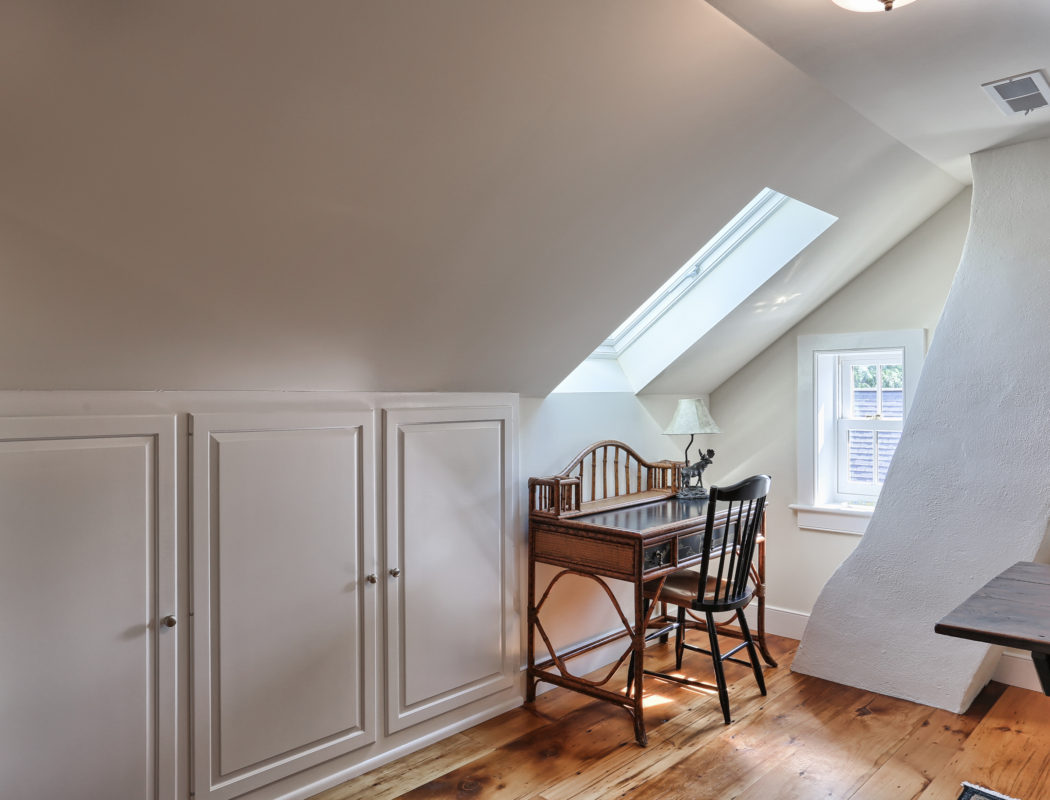 attic area with desk