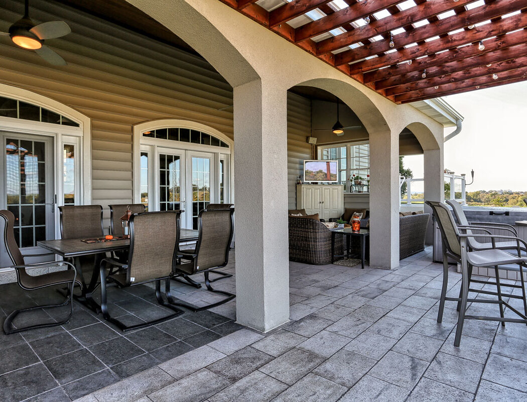 outdoor living area with furniture, a shade structure, and hardscaped patio