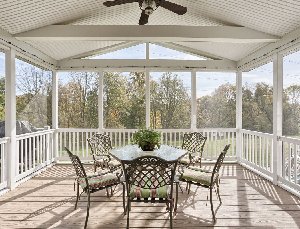 small patio set on a screened in porch