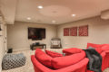 couch and TV area of a recently renovated basement