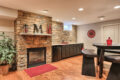 fireplace and stonewall in a finished basement