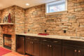 stone wall above kitchen countertops