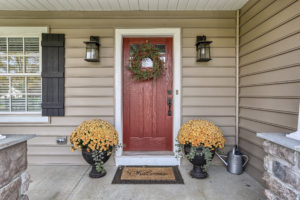 front porch with red door - built by custom home builder metzler home builders