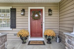 front porch with red door - built by custom home builder metzler home builders