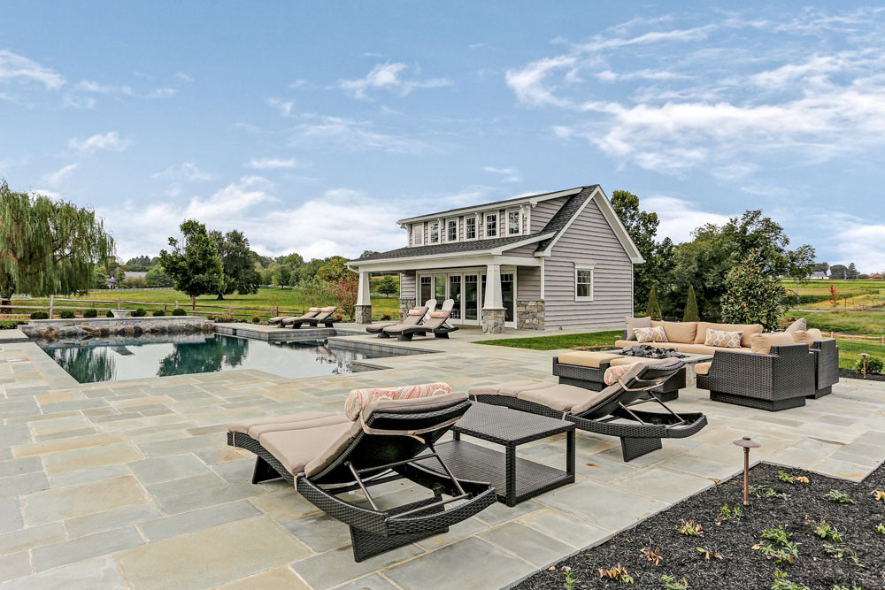 outdoor patio area surrounding a pool