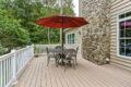 patio set with umbrella on a porch
