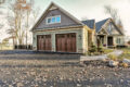 one story home - garage exterior - Built by Metzler Home Builders