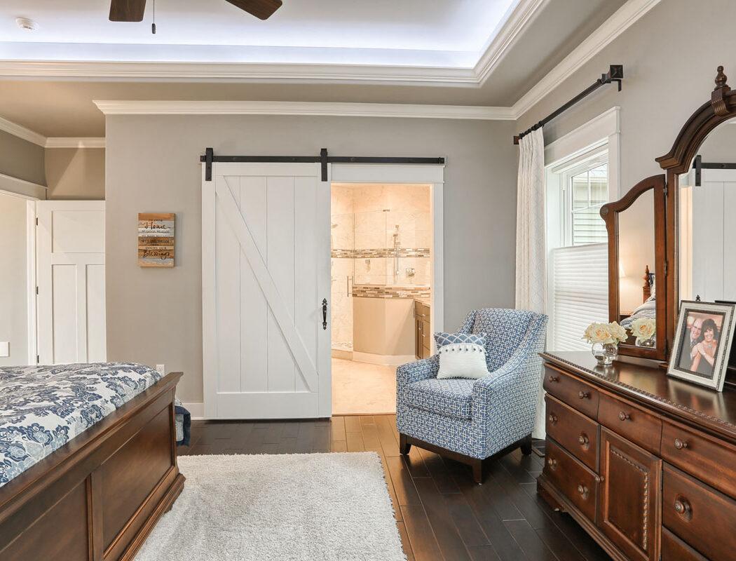 bedroom looking into custom bathroom with walkin shower